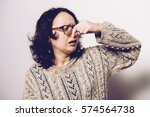 the stench. closes the woman's... | Shutterstock . vector #574564738