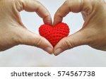 make heart shape with hands on...   Shutterstock . vector #574567738