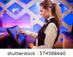 side view of young barmaid... | Shutterstock . vector #574588660