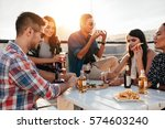 group of young people sitting... | Shutterstock . vector #574603240