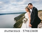 couple with a bouquet and... | Shutterstock . vector #574613608