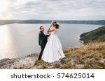 couple with a bouquet and... | Shutterstock . vector #574625014