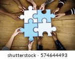 group of people holding puzzle... | Shutterstock . vector #574644493