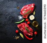 raw meat  beef steak on a stone ... | Shutterstock . vector #574660390