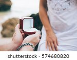 young couple is getting engaged ... | Shutterstock . vector #574680820