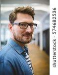portrait of smiling businessman ... | Shutterstock . vector #574682536