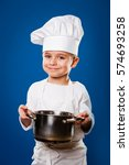 little chef standing in a... | Shutterstock . vector #574693258