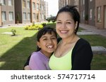 happy mother and daughter... | Shutterstock . vector #574717714