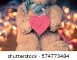 bear doll pick up red paper... | Shutterstock . vector #574773484