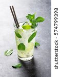mojito cocktail on dark stone... | Shutterstock . vector #574799398