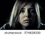 Small photo of lonely young teenager girl or woman in stress and pain suffering depression looking sad and scared with fear face expression isolated on black background victim of abuse or in mental condition