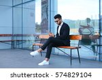 entrepreneur smiling man  puts... | Shutterstock . vector #574829104