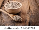 pepper in a bowl on wooden... | Shutterstock . vector #574840204