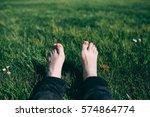 pale feet of the traveler on a...   Shutterstock . vector #574864774