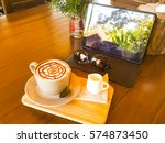 mocha coffee cup with sunglass... | Shutterstock . vector #574873450