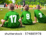 kids soccer players sitting on... | Shutterstock . vector #574885978