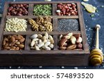 various nuts and seeds in a... | Shutterstock . vector #574893520