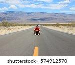 sitting in the desert. death... | Shutterstock . vector #574912570