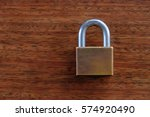 Padlock On The Brown Wooden...