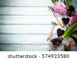 Stock photo workspace planting spring flowers garden tools hyacinth and plants in pots on a flat wooden 574923580
