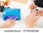 female hands using portable uv... | Shutterstock . vector #574938268