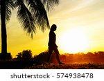 silhouette of people walking or ... | Shutterstock . vector #574938478