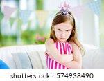moody little girl wearing... | Shutterstock . vector #574938490