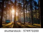 Adventures Camping tourism and tent under the view pine forest landscape near water outdoor  in morning and sunset sky at Pang-ung, pine forest park , Mae Hong Son,  Thailand. Concept Travel.  - stock photo