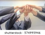 young business team in suit... | Shutterstock . vector #574995946