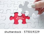 close up of girl's hand placing ... | Shutterstock . vector #575019229