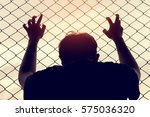 silhouette of a man behind the... | Shutterstock . vector #575036320