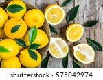 fresh lemons on market table ... | Shutterstock . vector #575042974
