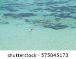 girl is snorkeling in the ocean ... | Shutterstock . vector #575045173