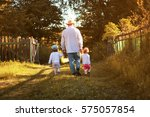 Kids Walk With Grandfather In...