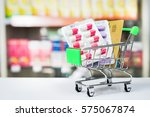 shopping trolley with blisters... | Shutterstock . vector #575067874