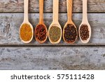 spices in wooden spoons. pepper ...   Shutterstock . vector #575111428
