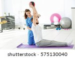 physiotherapist working with... | Shutterstock . vector #575130040