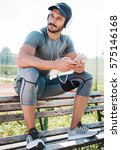 young muscular sportsman... | Shutterstock . vector #575146168