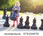 Child With Huge Chess Figures...