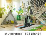 Small photo of Colorful kids play room with tent and hammock