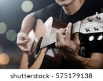 man playing acoustic guitar... | Shutterstock . vector #575179138