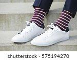 stripy socks and white sneaker... | Shutterstock . vector #575194270