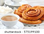 baked sweet cinnamon rolls with ... | Shutterstock . vector #575199100