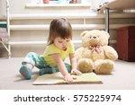 little girl reading book indoor ... | Shutterstock . vector #575225974