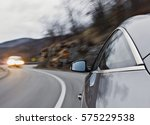 sports car driving fast in a... | Shutterstock . vector #575229538