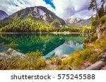 walk around the alpine lake... | Shutterstock . vector #575245588