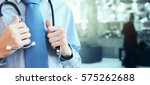 doctor with a stethoscope in... | Shutterstock . vector #575262688
