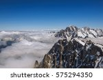 Snowy Peaks And Mountains In A...