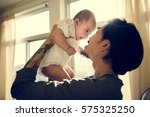 father is taking care of his... | Shutterstock . vector #575325250
