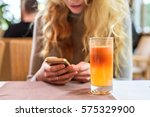 fresh apple juice on the table... | Shutterstock . vector #575329900